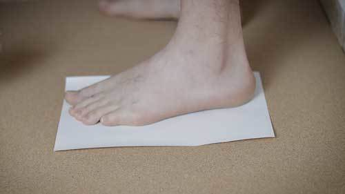 foot-on-paper