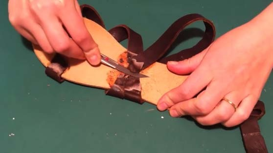 skiving of the sandals straps attached to the insole in the sandal making process
