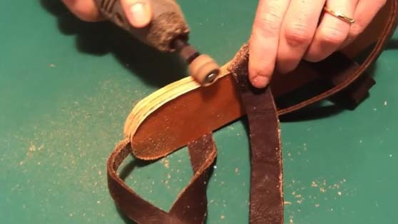 sanding the sandal's sole edge with dremel  during this sandals making