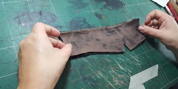 Attaching fabric to shoe leather