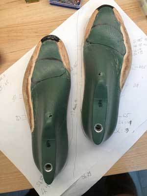 checking some of the student work in shoe last customization
